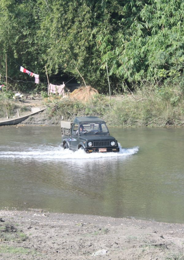 Safari Jeep crossing the river