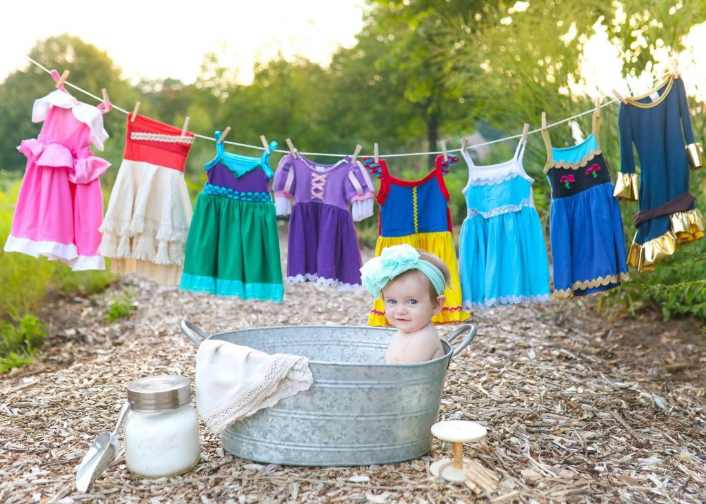 baby in tub with princess dresses