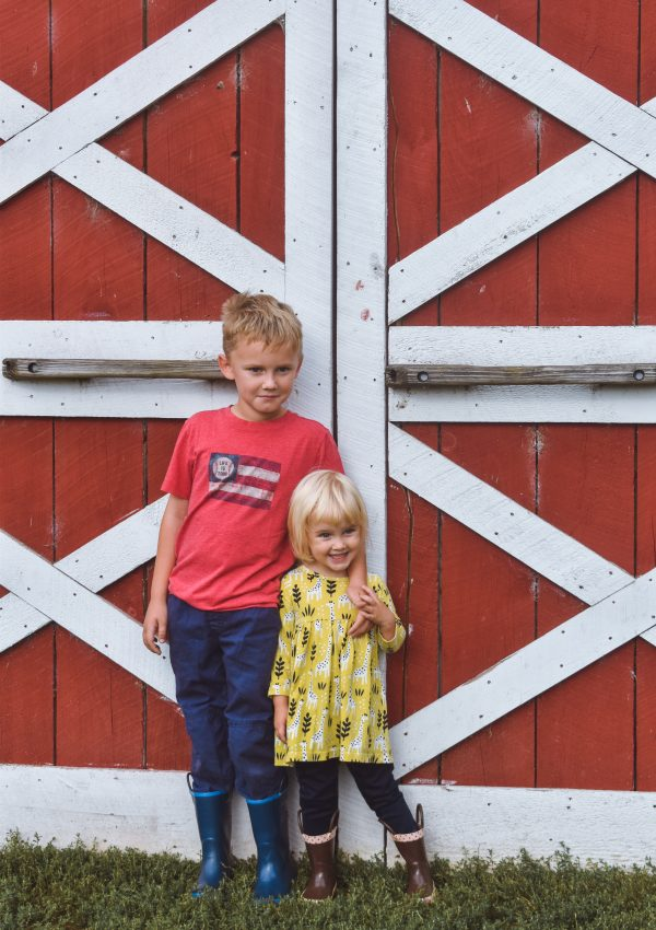 Kids in front of barn