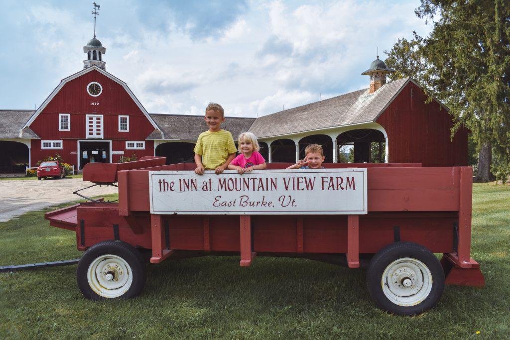 Kids in front of farm